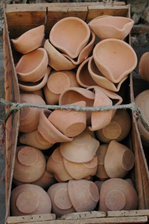 eldlery: KARACHIPAKISTAN_  Pakisani eldlery male selling  Pottery mug made clay 31 Oct 2012