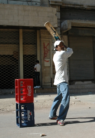 KARACHIPAKISTAN_  Pakistani playing circket on street Cricket sport is in Pakistani blood  Pakistani do not care if they have no play ground they can make cirkcet day on thier streets 5 Nov. 2012