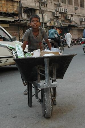 rupees: KARACHIPAKISTAN_  Child labor or helping family to make few rupees pakistani money 6 Nov. 2012     Editorial