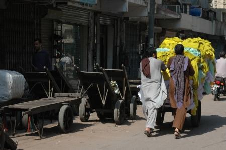 KARACHI/PAKISTAN_ Pakistani vendors pushing heavy good 6 Nov 2012         Stock Photo - 16224935