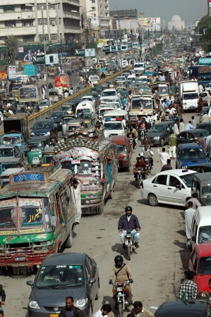 millions: KARACHIPAKISTAN_    Trafic jam on M.A.Jinnha road Karachi as 13 millions populations largest city of Pakistan 4 February 2013