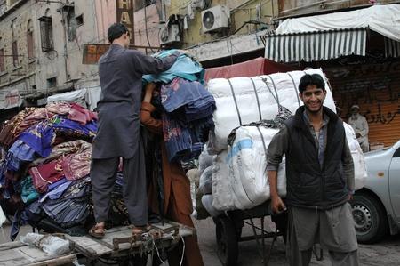 bazar: KARACHIPAKISTAN_  Flea market vandors  or secondhand cloths bazar daily business life is on footpath 6 Feb 2013