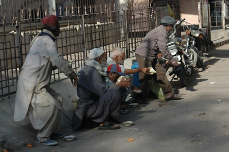 KARACHIPAKISTAN_ Poverity hit hard in Pakistan due high inflation and lower wages people can not afford their daily food males waiting for free food from chairty 10 Feb. 2013
