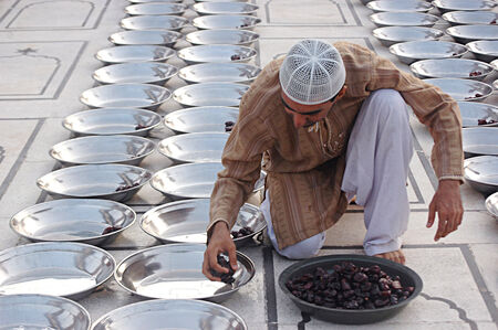 Karachi Pakistan-  Male preparing dates  for people those are fasting on Ramadan feast at local place or in mosque        1 July  2014    Editorial