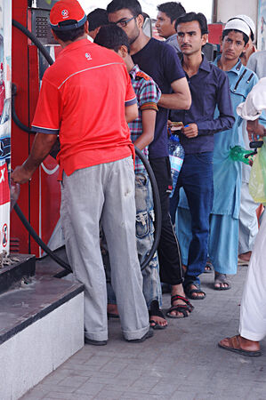 Karachi Pakistan- Pakistan staning in line to get gasolines at gas station during holy month of Ramadan          01 July 2014