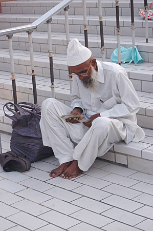 Karachi Pakistan- Elderly or senior counting money          01 july 2014