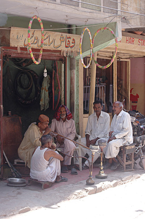 Karachi Pakistan-  Pakistan male smoking water pipe in Pakistani m urdu langaueg called Hoka        01 July 2014  (Photo by Ilyas Dean)