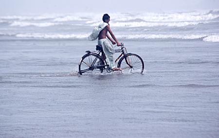Karachi Pakistan- Pakistani cool down in arabian ocean in Karachi on clifton seaview are today          02 July 2014