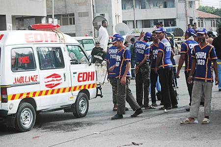 Karachi Pakistan- Police inspects  Bomb blast in Karachi busy area sadar  preddy street ourside the mosque 2 dead and 3 injuurd today  on        04 July 2014