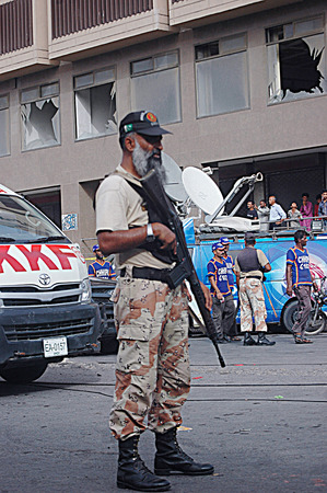 Karachi Pakistan- Police inspects  Bomb blast in Karachi busy area sadar  preddy street ourside the mosque 2 dead and 3 injuurd today  on        04 July 2014