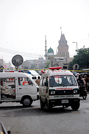 Karachi Pakistan- Police inspects  Bomb blast in Karachi busy area sadar  preddy street ourside the mosque 2 dead and 3 injuurd today  on        04 July 2014   Editorial