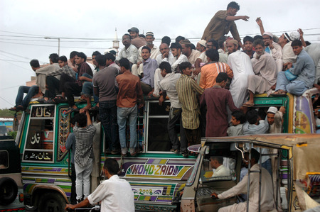 Karachi Pakistan- Pakistani spend most of time during transport to work and from work to home there is bus shortage in Pakistan there is no bubic bus system and most fo the time people have to find place on busroofs which is dangerous and people of Pakis Editorial