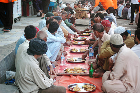 Karachi Pakistan- Pakistani life during ramadan people eating free food at one of local chairty place          07 July 2014   Editorial