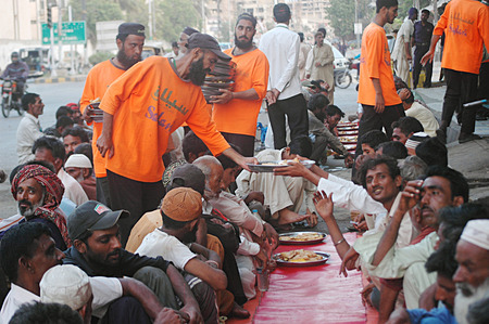 karachi: Karachi Pakistan- Pakistani life during ramadan people Salani welfare trust distribute free food during ramadan           07 July 2014