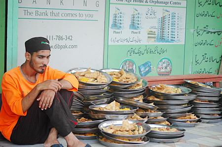 Karachi Pakistan- Pakistani life during ramadan people Salani welfare trust distribute free food during ramadan