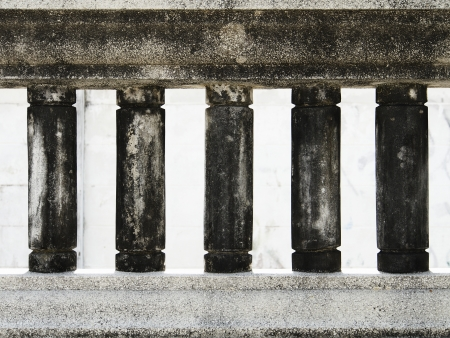 Dark old dirty balustrade in cylinder shape photo