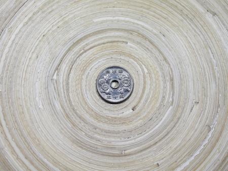 Japanese Fifty Yen Coin on Bamboo Circular Tray Stock Photo