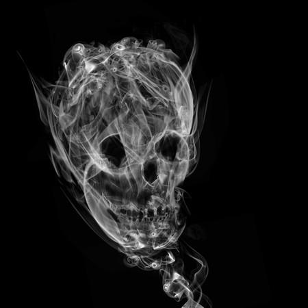 煙、黒の背景の髑髏 写真素材