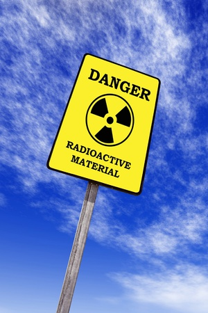 toxic accident: radioactivity billboard on a blue sky with clouds