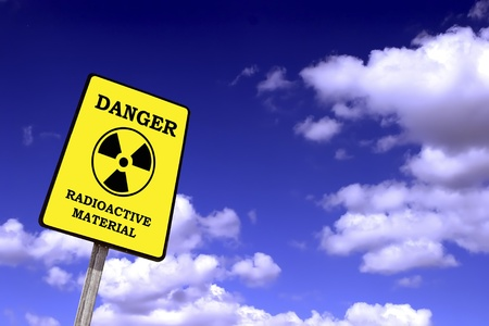 fukushima: radioactivity billboard on a blue sky with clouds