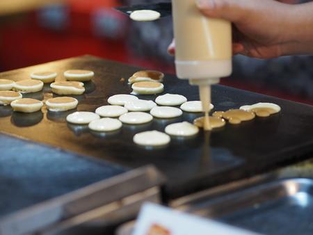 cooking pancake Dessert on steel pan