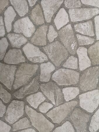 gray stone freeform block brick floor rough surface texture material background Archivio Fotografico - 129274522