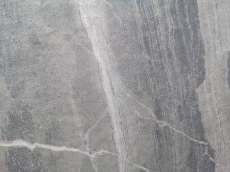 Granite stone wall gray color rough surface texture material background Archivio Fotografico - 129274529