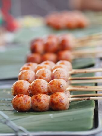 Artificial sausage Thai sausage casing cooking twine made from minced pork and rice take to grill put on green banana leaves Reklamní fotografie