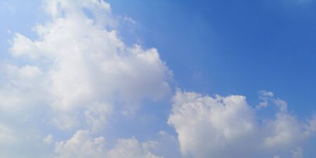 white clouds in the blue sky natural background beautiful nature space for write