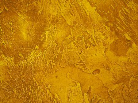 Oberfläche der Wand ist rau, Farbe in Gold Textur Material Hintergrund material
