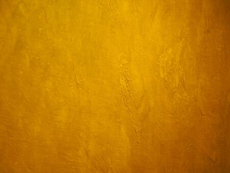 surface of the wall is rough, paint in gold texture material background