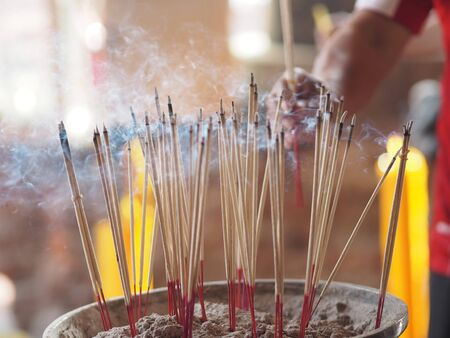 Incense stick for praying buddha image Stuck in the incense burner have Smoky in the temple, Thailand
