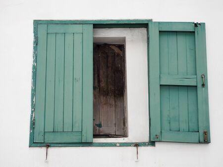 Open green wood old window on white wall, Retro house Reklamní fotografie