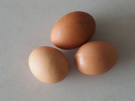 Fresh three eggs on white background
