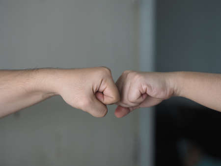 Two woman Alternative handshakes Fist collision Bump greeting in the situation of an epidemic covid 19, coronavirus