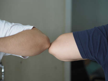 Two woman Alternative handshakes Elbow Bump greeting in the situation of an epidemic covid 19, coronavirus