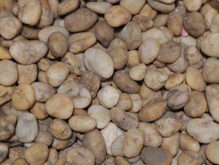 Background of small pebbles round sea stones texture rocks material 版權商用圖片