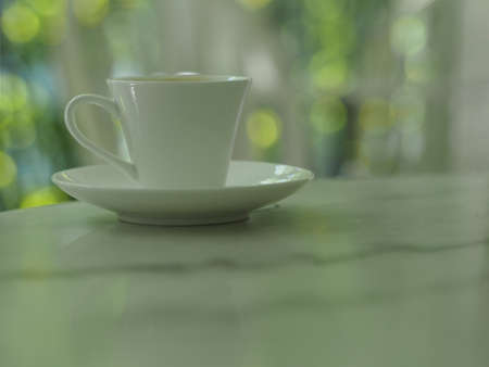 Coffee cup put on marble table, bokeh with blurred of background
