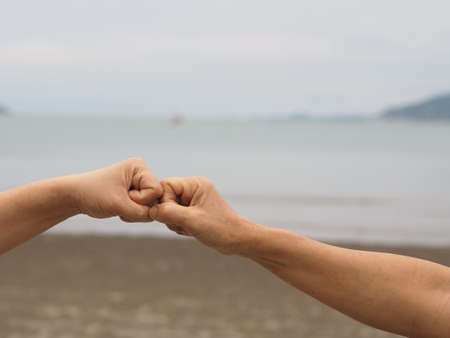 Two woman Alternative handshakes fist clenched hand greeting in the situation of an epidemic covid 19, coronavirus new normal social distancing