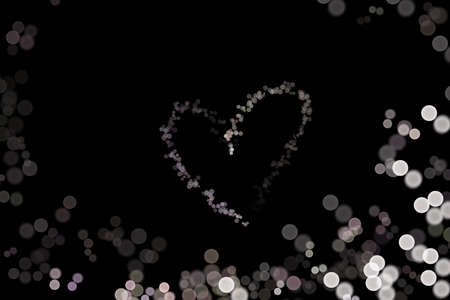 Abstract bokeh background shape heart on black background, love Valentine Day, for copy text card, white light dot background