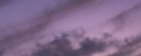 Great sky with sunset clouds all possible shades of pink and purple, big nature background.
