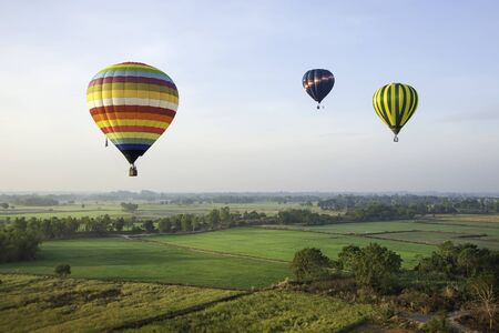 balloons green: Colorful ballloons over green rice field of Thailand