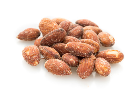 Salted and roasted almonds isolated.