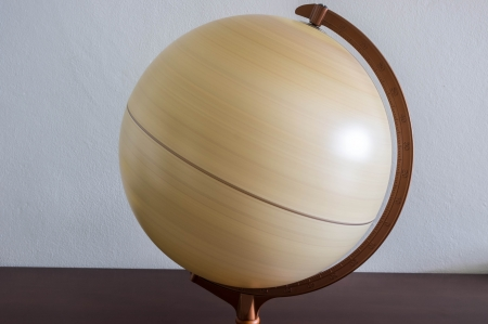 earth moving: desktop globe with scale spinning round shows how the earth moving Stock Photo