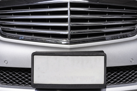 license plate: closeup shot of luxury car empty license plate