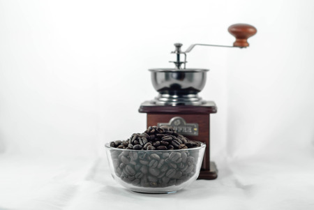coffee bean and coffee grinder isolated in white background photo