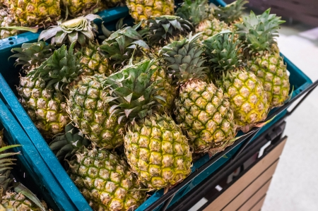 pineapple selling in supermarket photo
