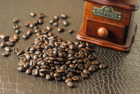 fresh coffee bean with classic coffee grinder photo