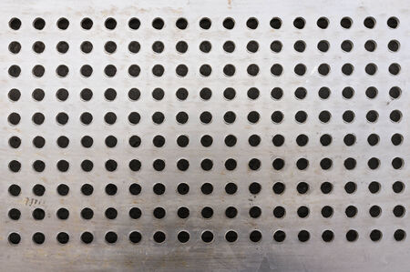 metalic steel background with round hole pattern Stock Photo