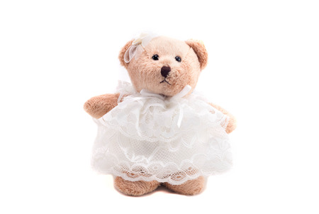 cute teddy bear in wedding dress isolated in white background with clipping path photo